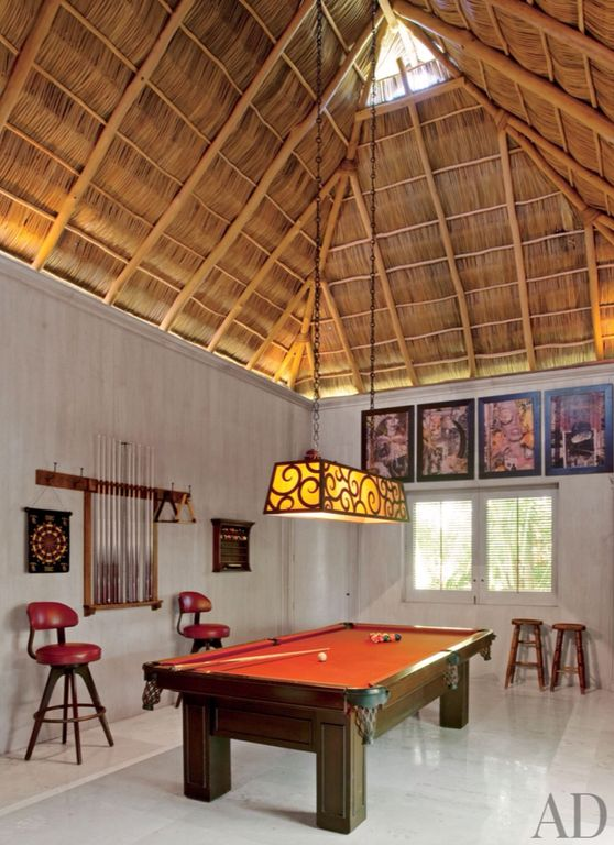 Tropical Game Room with specialty window, Cathedral ceiling, flat door, stone tile floors, simple marble tile floors