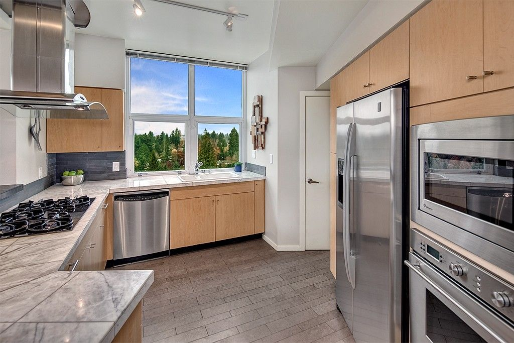Contemporary Kitchen with Slate Tile, Casement, Wall Hood, can lights, Stone Tile, U-shaped, wall oven, dishwasher, Paint 1