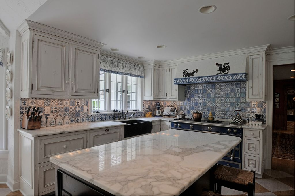 country kitchen with mexican tile backsplash carrara marble