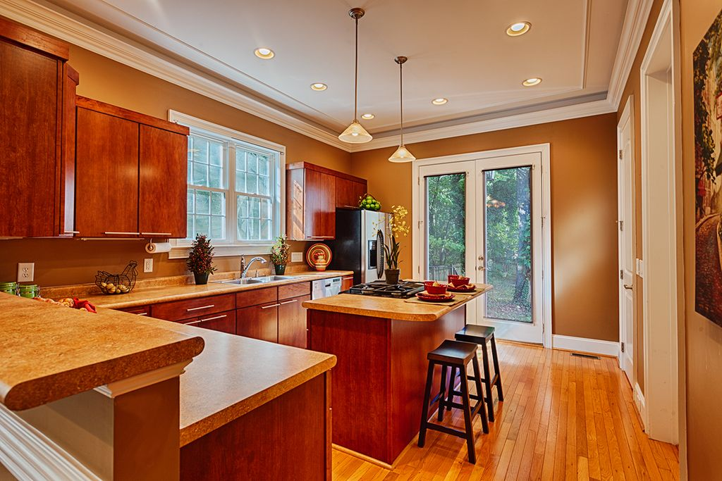 Contemporary Kitchen with Multiple Sinks, partial backsplash, Built In Refrigerator, Flush, Simple Granite, electric cooktop