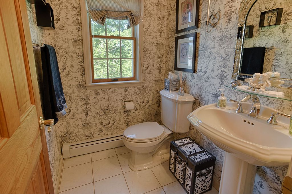Traditional Powder Room with limestone tile floors, High ceiling, Pedestal sink, double-hung window, interior wallpaper