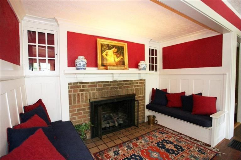 Traditional Living Room with Wainscotting, Hardwood floors, Standard height, Built-in bookshelf, Crown molding, Fireplace