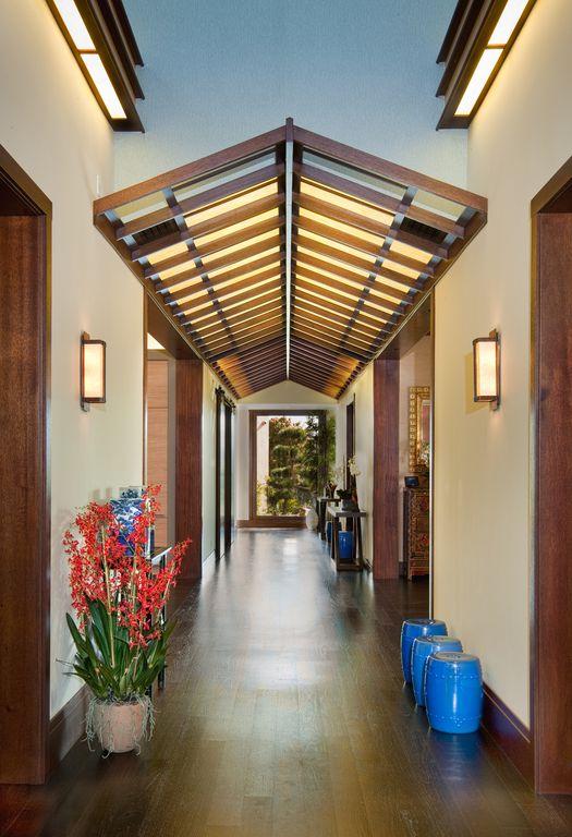Asian Hallway with Paint, Sconce wall light, Hardwood floors, Pier1 - garden stool