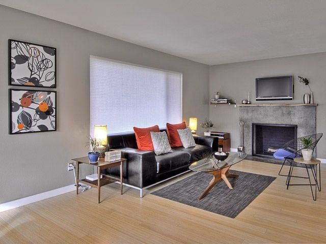 Contemporary Living Room with Standard height, Laminate floors, Fireplace, Cement fireplace