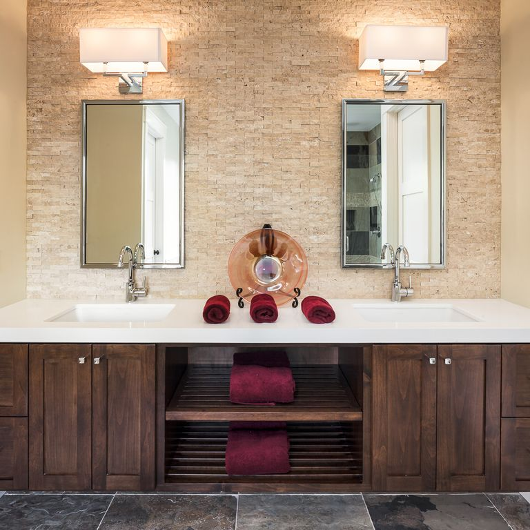 Transitional Master Bathroom with Stone Tile, specialty door, Double sink, Limestone Tile, Corian counters, Master bathroom