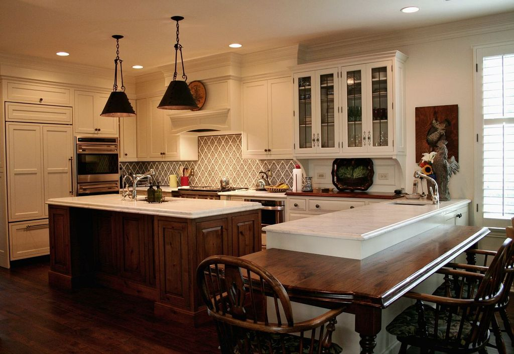 Traditional Kitchen with can lights, U-shaped, full backsplash, Walker Zanger Bianco Bello Marble, Pendant light, wall oven