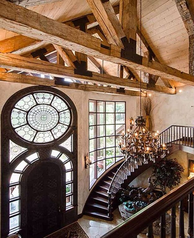 Rustic Entryway with specialty window, specialty door, simple marble floors, High ceiling, Chandelier, Wall sconce