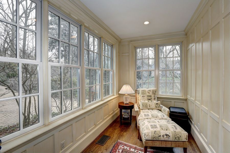 Traditional Living Room with Crown molding, can lights, Standard height, double-hung window, Hardwood floors