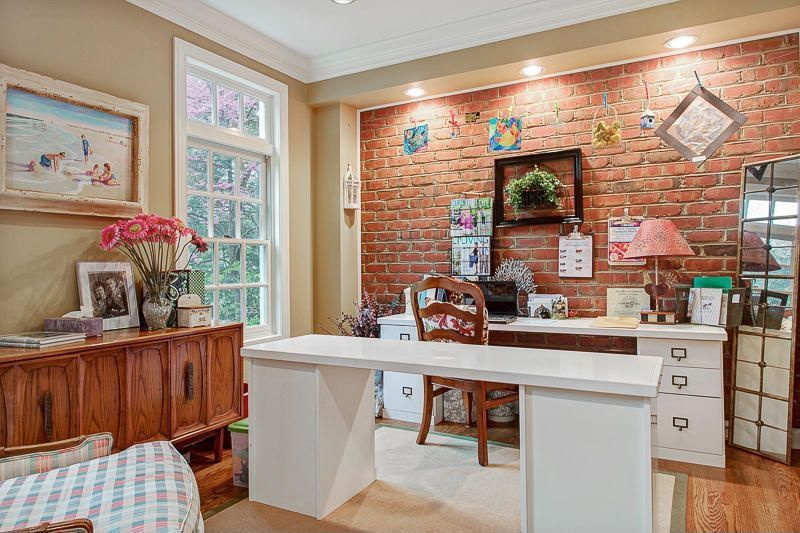 Eclectic Home Office with double-hung window, interior brick, Standard height, Hardwood floors, Crown molding, can lights