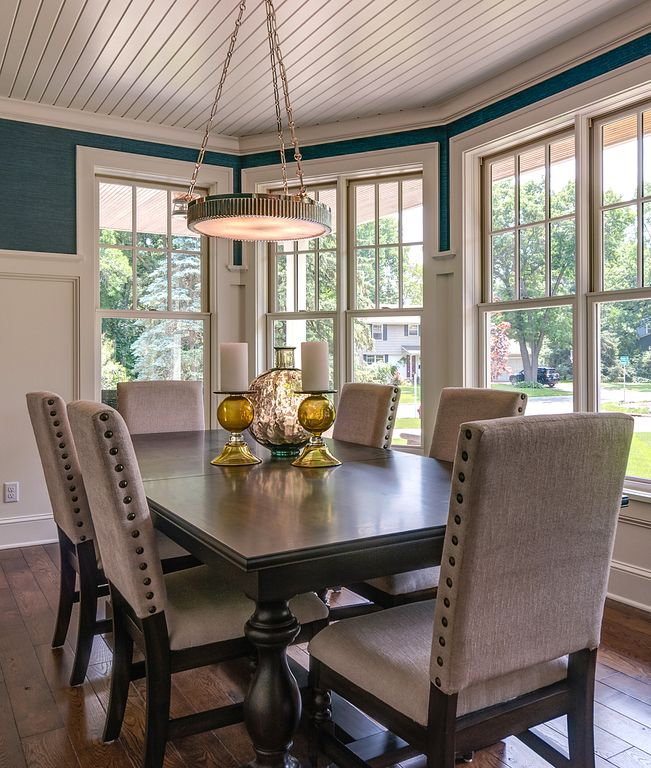 Contemporary Dining Room with Crown molding, double-hung window, Pendant light, Hardwood floors, Standard height, Paint