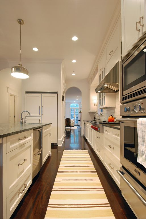 Traditional Kitchen with Paint 1, Dark green marble countertop, Built In Panel Ready Refrigerator, Arched doorway