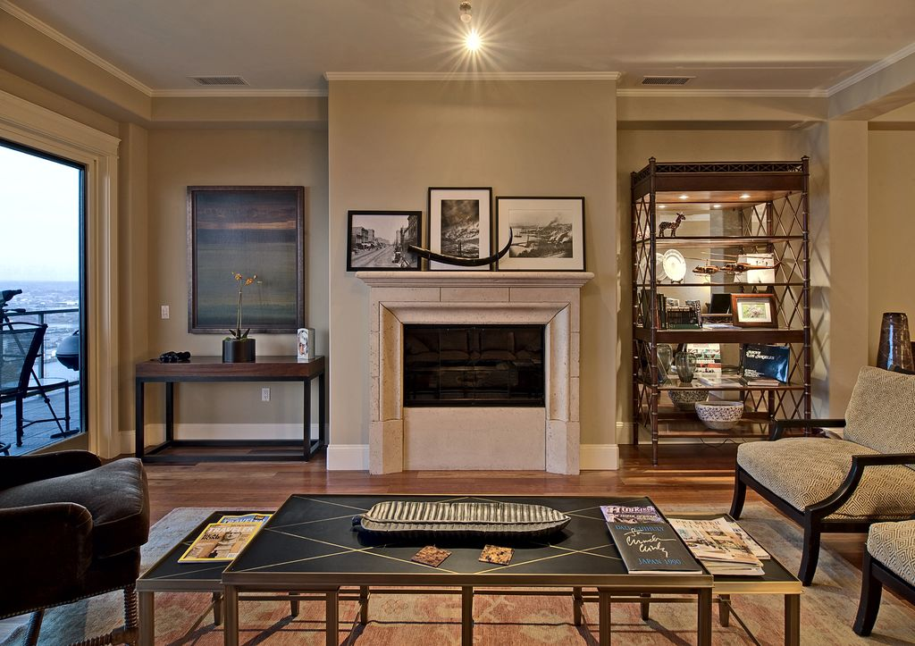 Traditional Living Room with Crown molding, Standard height, stone fireplace, picture window, Fireplace, flush light