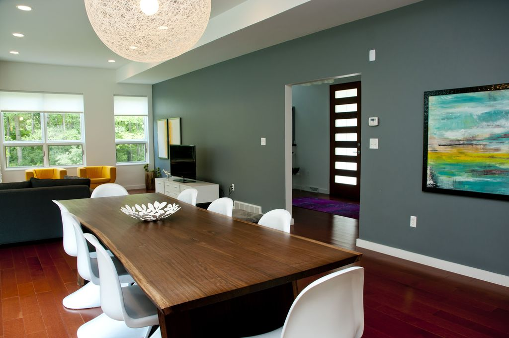 Modern Dining Room with Paint, Stainless steel stockholm bowl, flush light, Hardwood floors, Vitra verner panton chair