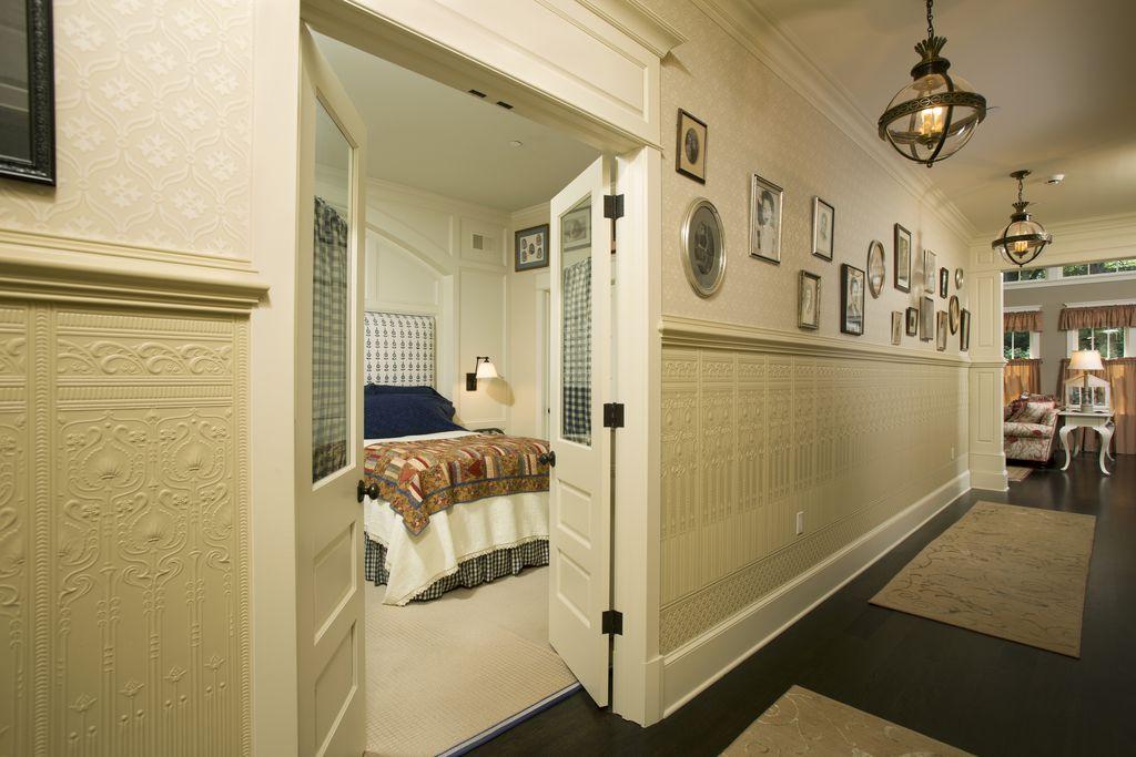 Traditional Hallway with Crown molding, interior wallpaper, French doors, Pendant light, Hardwood floors, Wainscotting