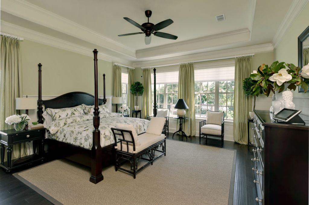 Traditional Master Bedroom with double-hung window, Crown molding, Standard height, Ceiling fan, Hardwood floors