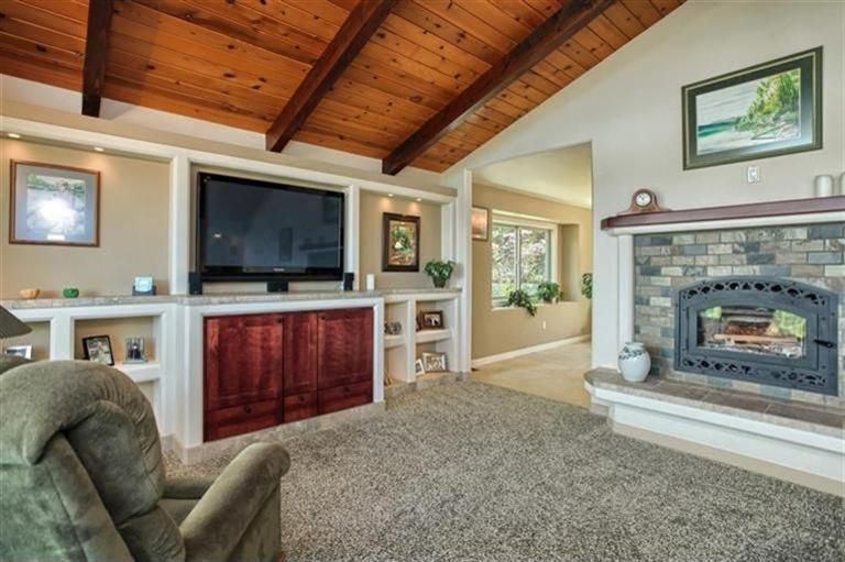 Craftsman Living Room with Exposed beam, metal fireplace, Built-in bookshelf, Carpet, stone fireplace