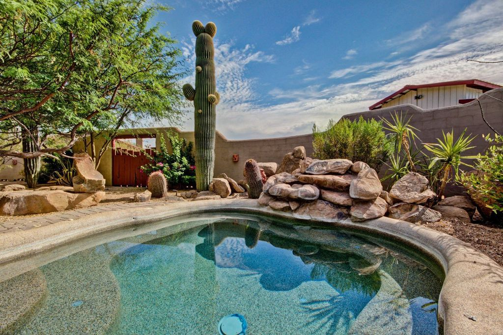 Mediterranean Swimming Pool with Natural rock, exterior stone floors, Desert landscaping, Fence, Paint, privacy wall, Gate
