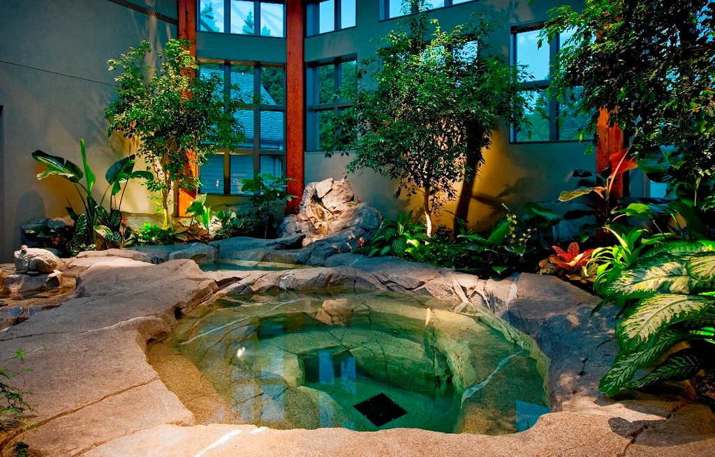 Eclectic Hot Tub with exterior stone floors, picture window, Pond, Sunken hot tub