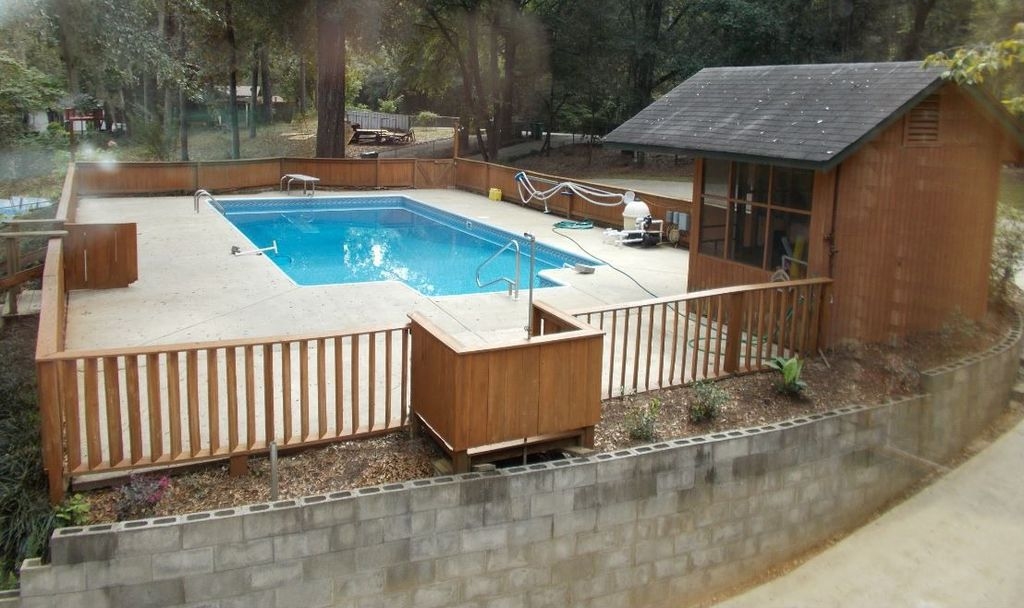 Rustic Swimming Pool with Fence, Pathway, exterior concrete tile floors, exterior tile floors, Deck Railing, Gate
