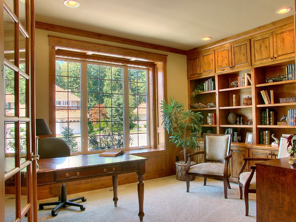 Traditional Home Office with French doors, Carpet, Wainscotting, Crown molding, Built-in bookshelf, Window seat, can lights