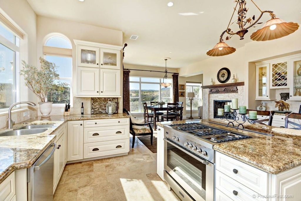 Traditional Kitchen with Breakfast nook, Kitchen island, Breakfast bar, Stone Tile, full backsplash, Standard height, Flush