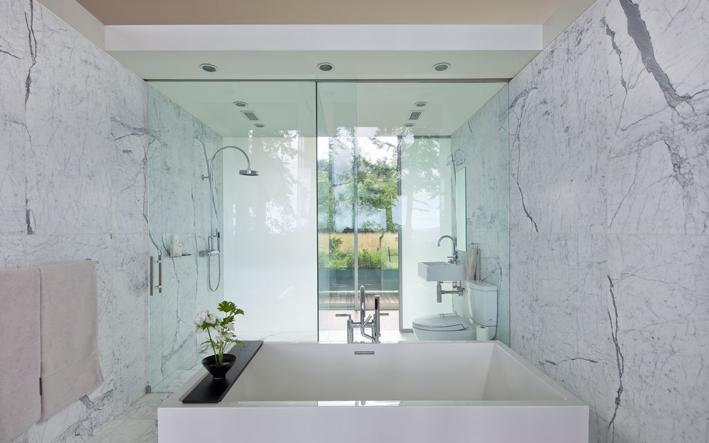 Contemporary Master Bathroom with can lights, stone tile floors, Undermount bathroom sink, Standard height, Wall Tiles