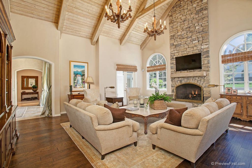 Traditional Living Room with Virginia mill works golden teak acacia handscraped, Arched window, stone fireplace, Fireplace