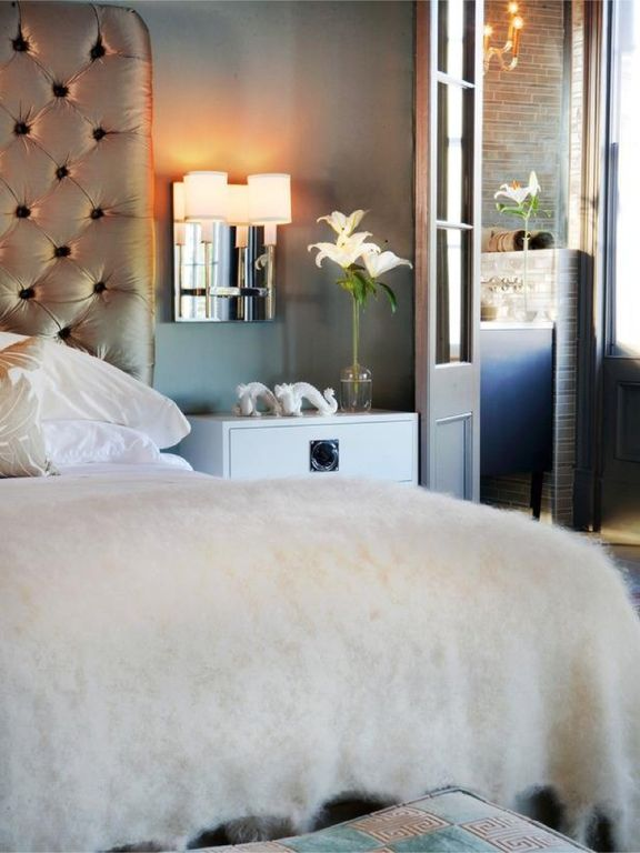Contemporary Master Bedroom with Standard height, Hardwood floors, Wall sconce