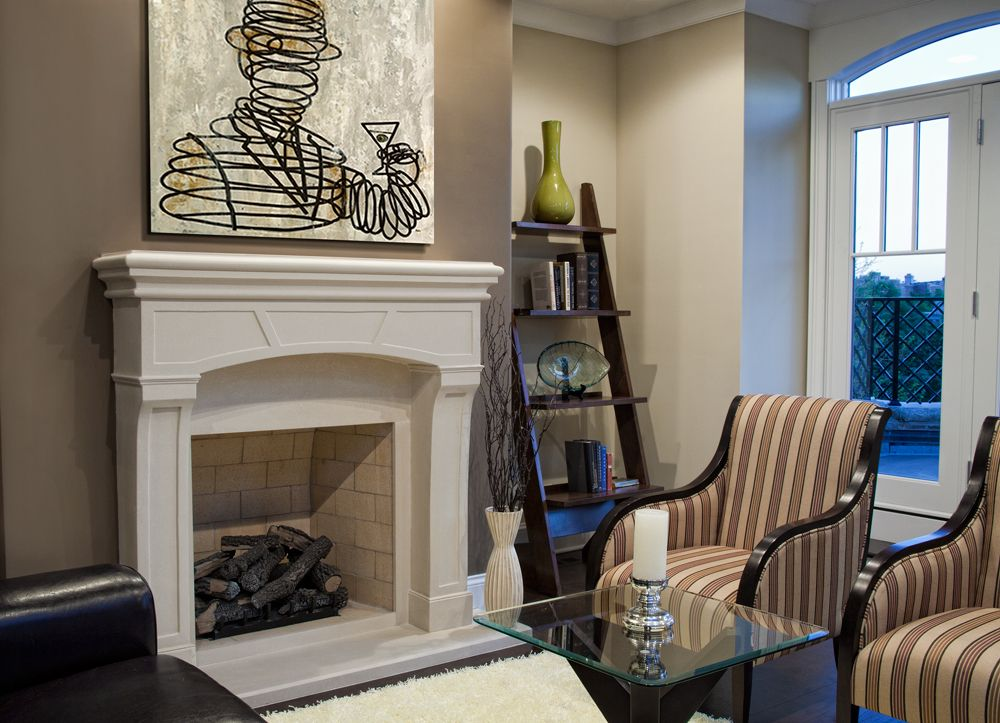Traditional Living Room with French doors, Arched window, Hardwood floors, Fireplace, Standard height, brick fireplace