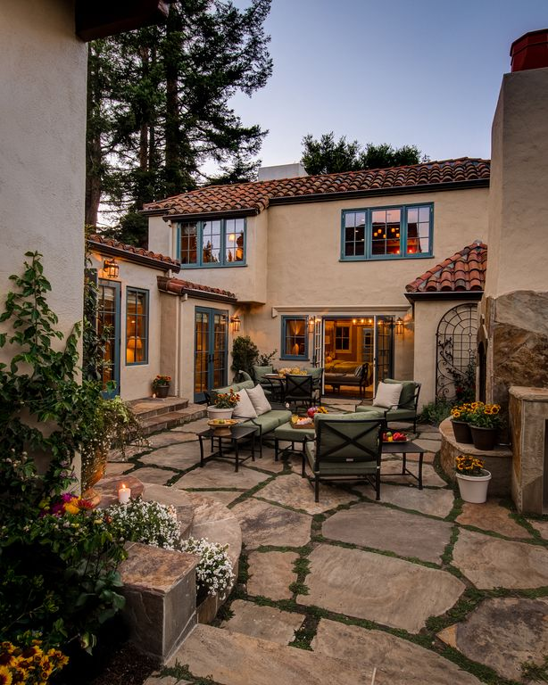 Mediterranean Patio with Outdoor furniture, Casement, French doors, Flagstone patio, exterior stone floors