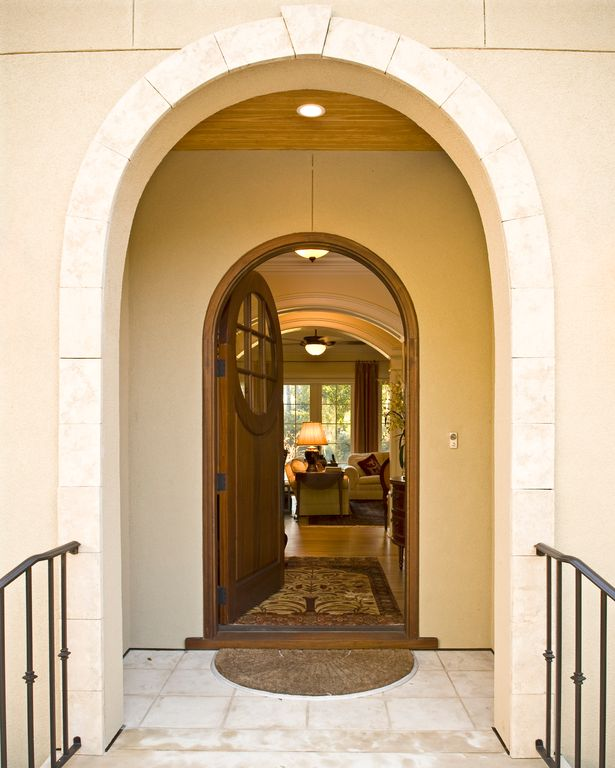 Traditional Front Door with exterior stone floors, Deck Railing, Pathway, Glass panel door