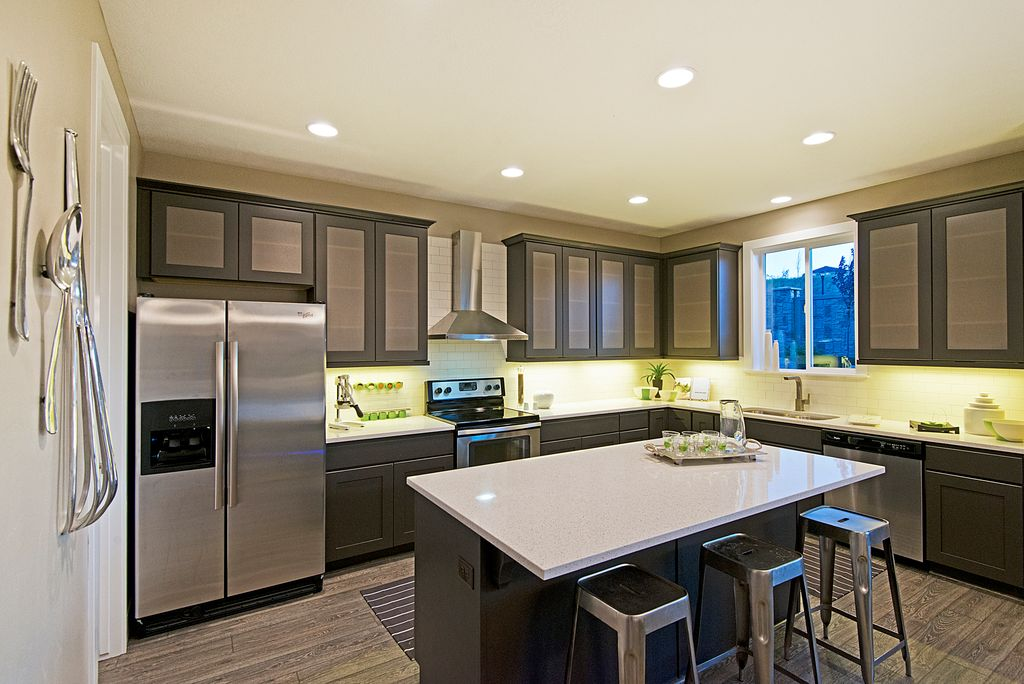 Contemporary Kitchen with Flush, European Cabinets, full backsplash, Wall Hood, Breakfast bar, Glass panel, Casement