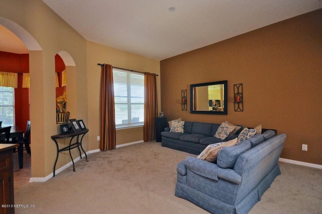 Traditional Living Room with Carpet & Wall sconce in Jacksonville, FL Zillow Digs