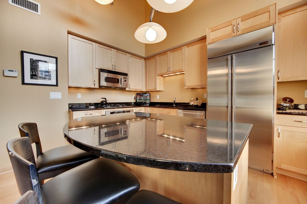 Contemporary Kitchen with L-shaped, Quartz, European Cabinets, partial backsplash, flush light, Breakfast bar, wall oven