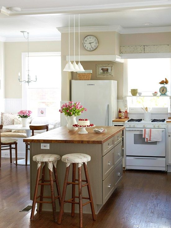 Kitchen with Flat panel cabinets, Standard height, Freestanding Full Size Top Freezer Refrigerator, Crown molding, can lights
