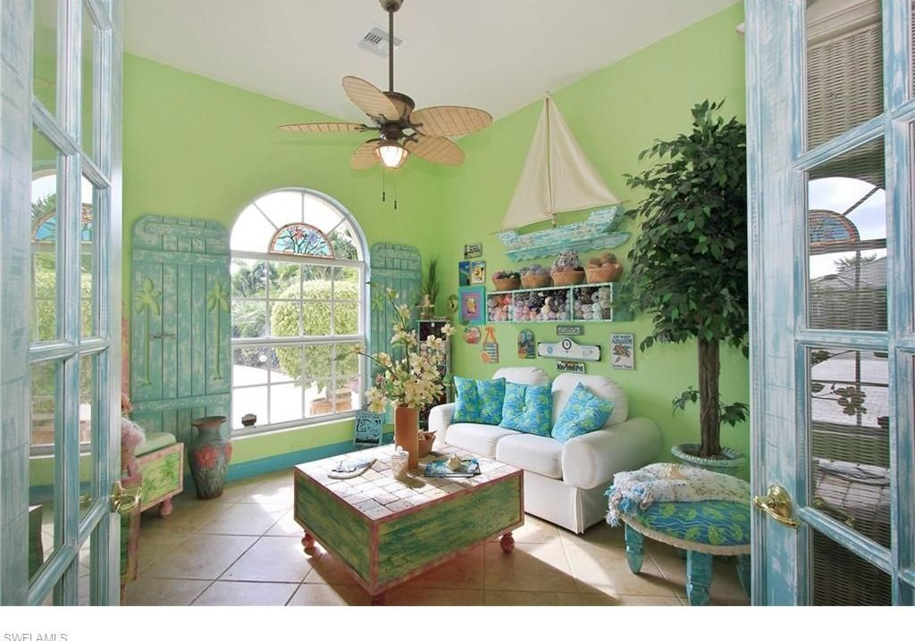 Tropical living room with high ceiling ceiling fan in for Caribbean living room ideas