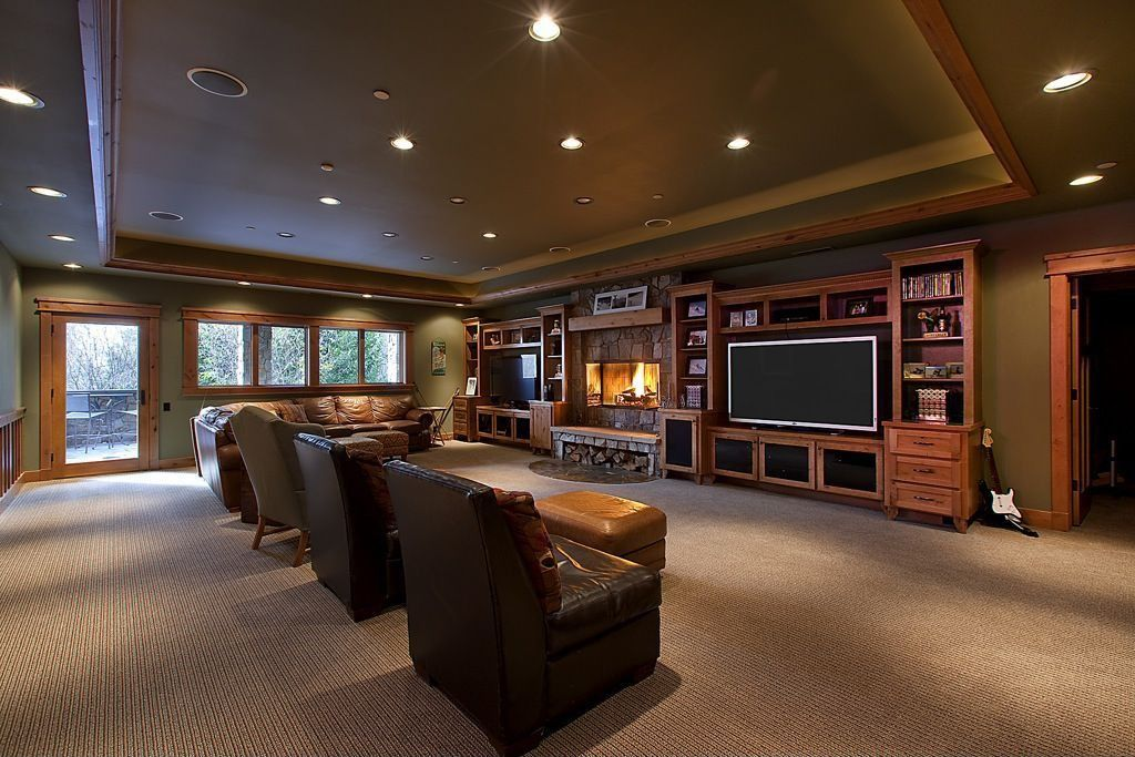 Craftsman Living Room with French doors, Fireplace, Standard height, Casement, Built-in bookshelf, stone fireplace, Carpet