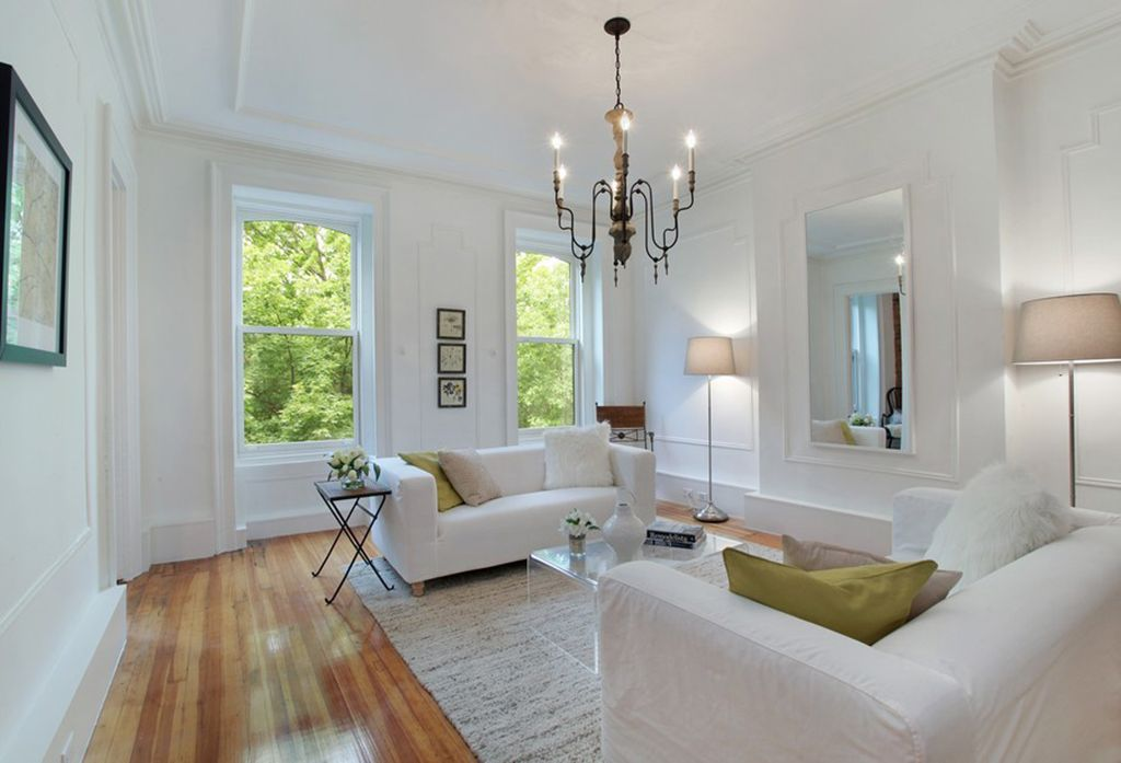 Contemporary Living Room with Crown molding, double-hung window, Hardwood floors, Standard height, Chandelier