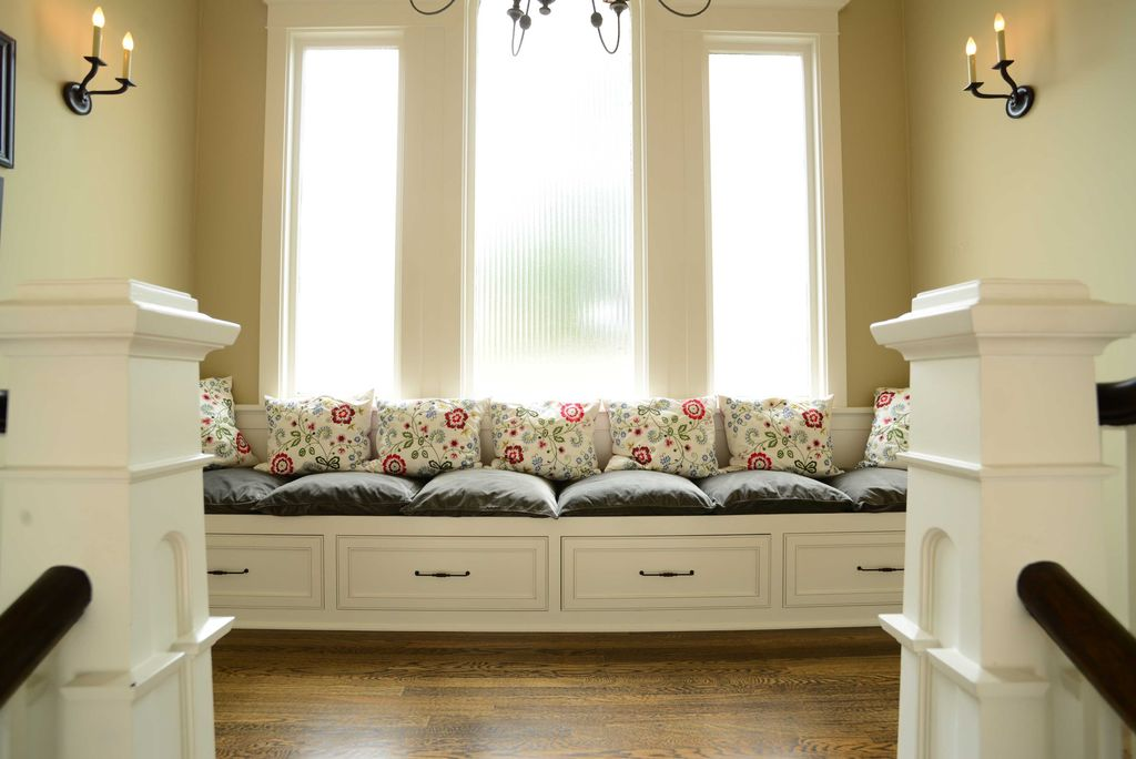 Traditional Hallway with Hardwood floors, Wall sconce, Standard height, Chandelier, Columns, Window seat, picture window