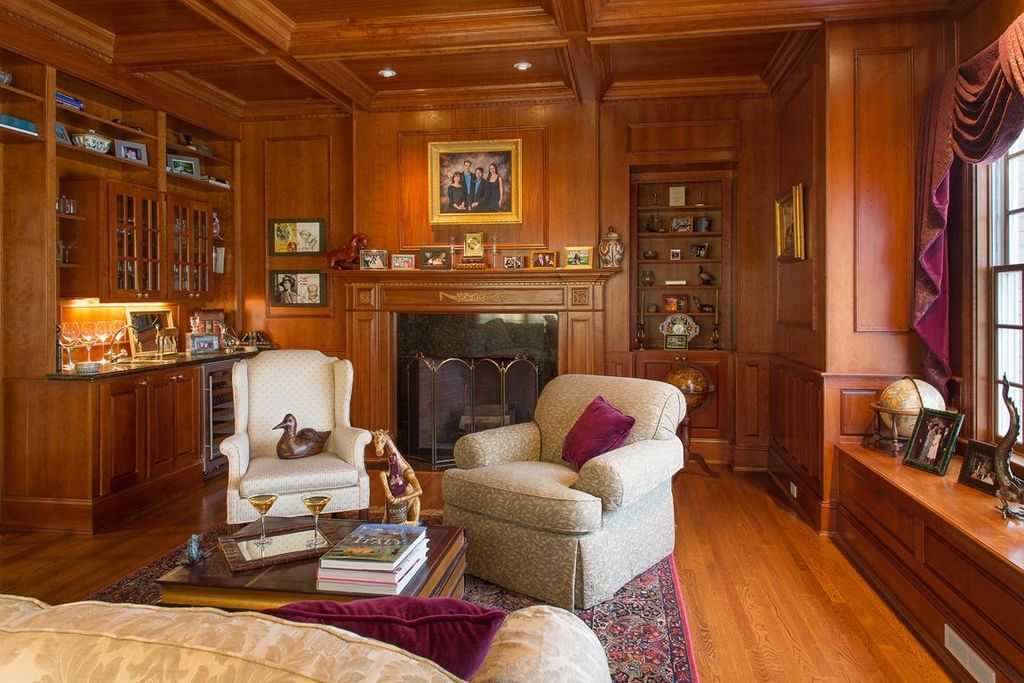 Traditional Living Room with Hardwood floors, stone fireplace, Crown molding, Built-in bookshelf, Wainscotting, Box ceiling