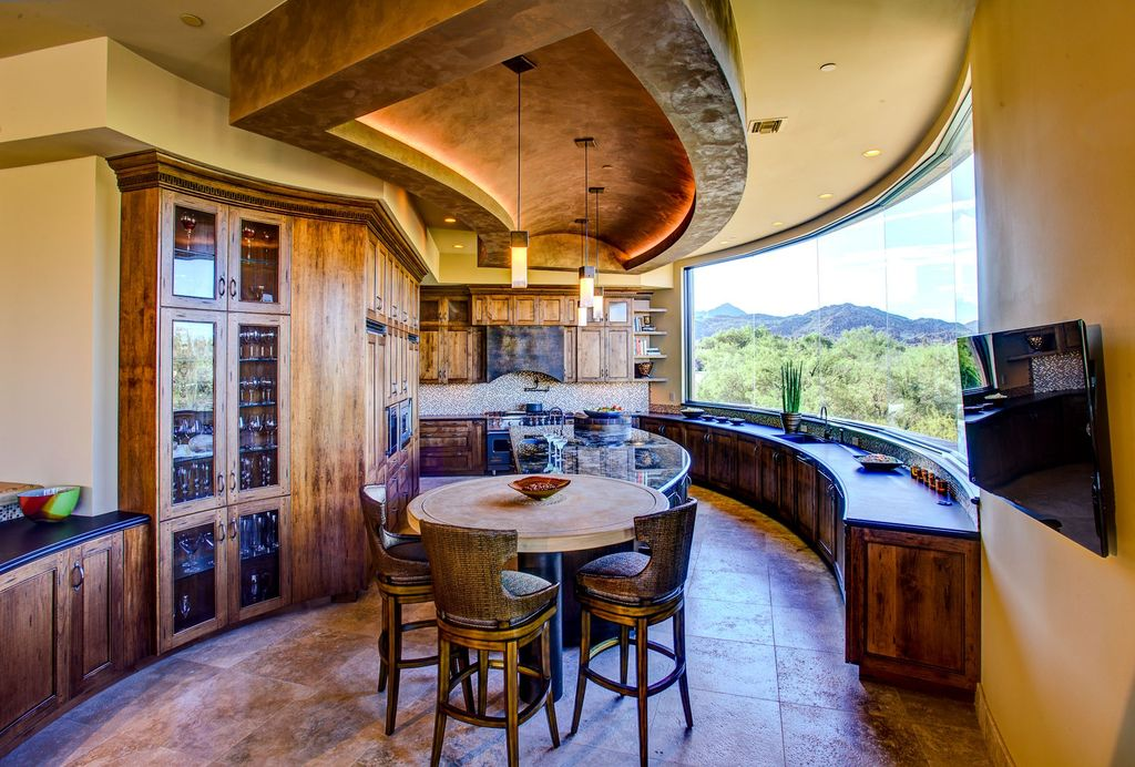 Eclectic Kitchen with Built In Panel Ready Refrigerator, stone tile floors, Simple Granite, Custom hood, wall oven, U-shaped