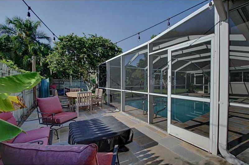 Contemporary Patio with Fence, Fire pit, picture window, Skylight, French doors, Atrium, Transom window, Outdoor cushion