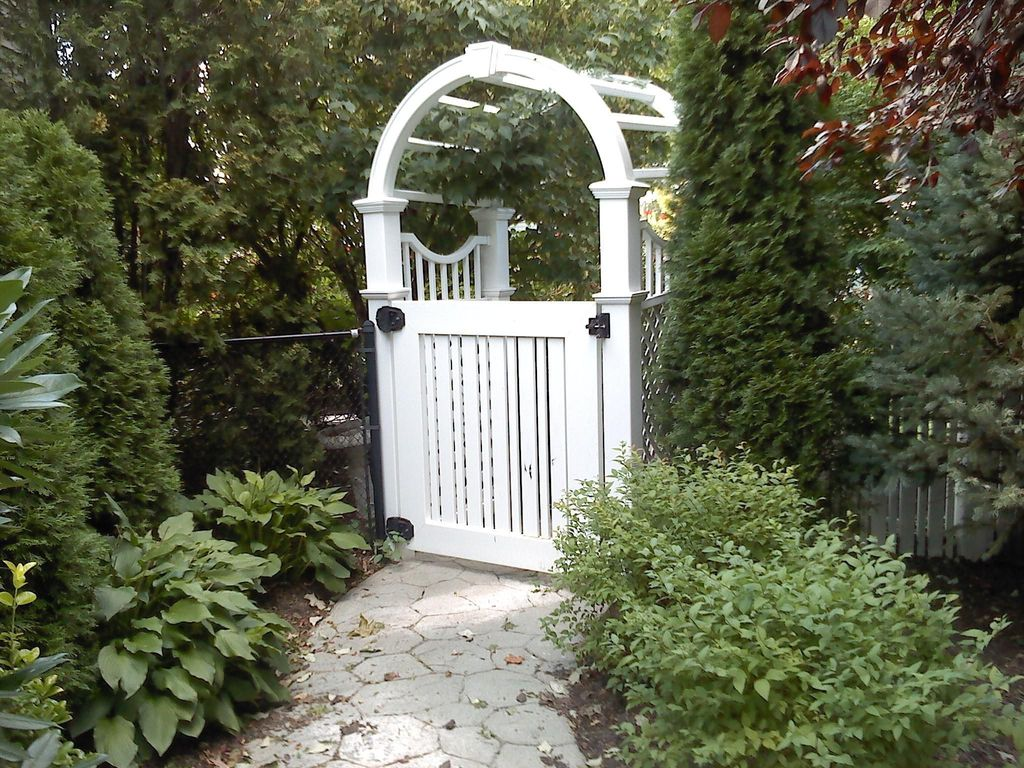 Traditional Landscape/Yard with Fence, Arbor, Pathway, exterior stone floors