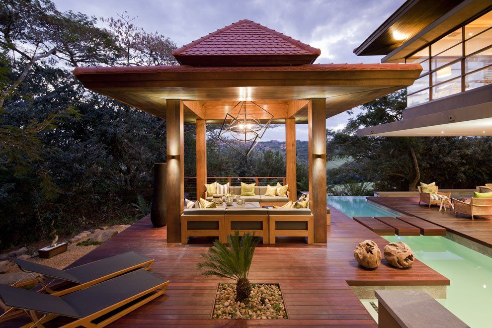Modern Patio with Pathway, Gazebo, Pond, picture window, Deck Railing