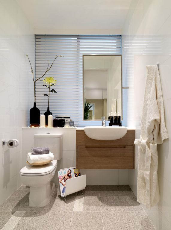 Contemporary Powder Room with Statements white wall tile - white gloss, Corian counters, Flush, Powder room, Standard height