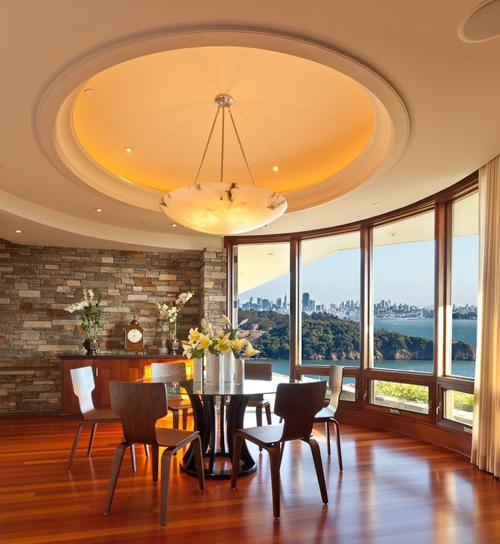 Modern Dining Room with picture window, Laminate floors, High ceiling, can lights, Glass panel door, Chandelier, Casement