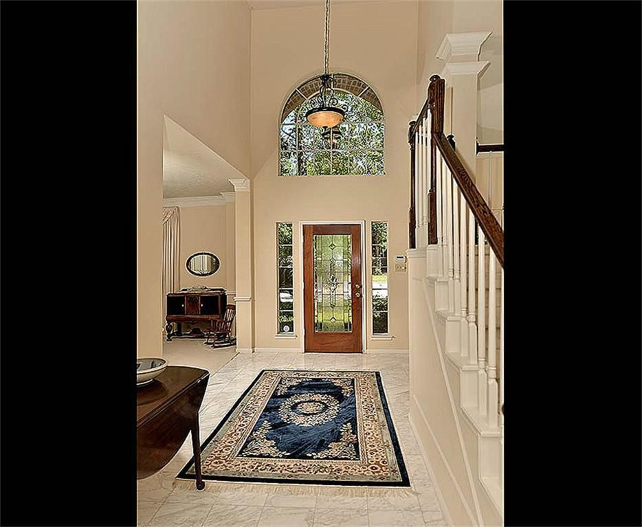 Traditional Entryway with sandstone tile floors, stone tile floors, Cathedral ceiling, Arched window, Paint, Pendant light