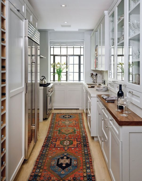 Traditional Kitchen with Glass panel cabinets, sandstone tile floors, Glass panel, Carpet floor runner, Built in wine storage