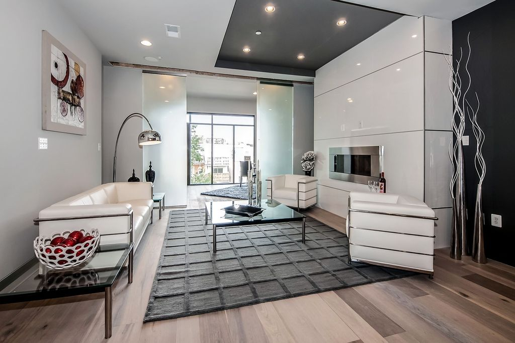 Contemporary Living Room with Hardwood floors, Standard height, Mason white leather sofa, Fireplace, insert fireplace, Paint
