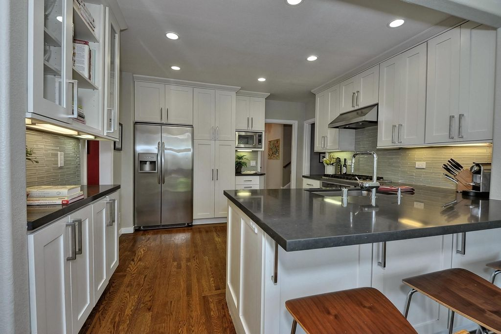 Contemporary Kitchen with Undermount sink, wall oven, Ceramic Tile, full backsplash, built-in microwave, can lights, Paint 1